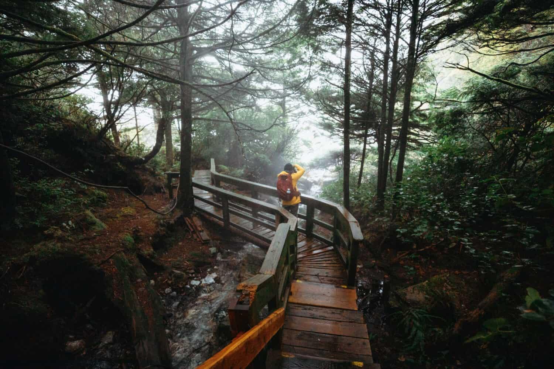Berty Mandagie standing on board walk near hot springs - TheMandagies.com