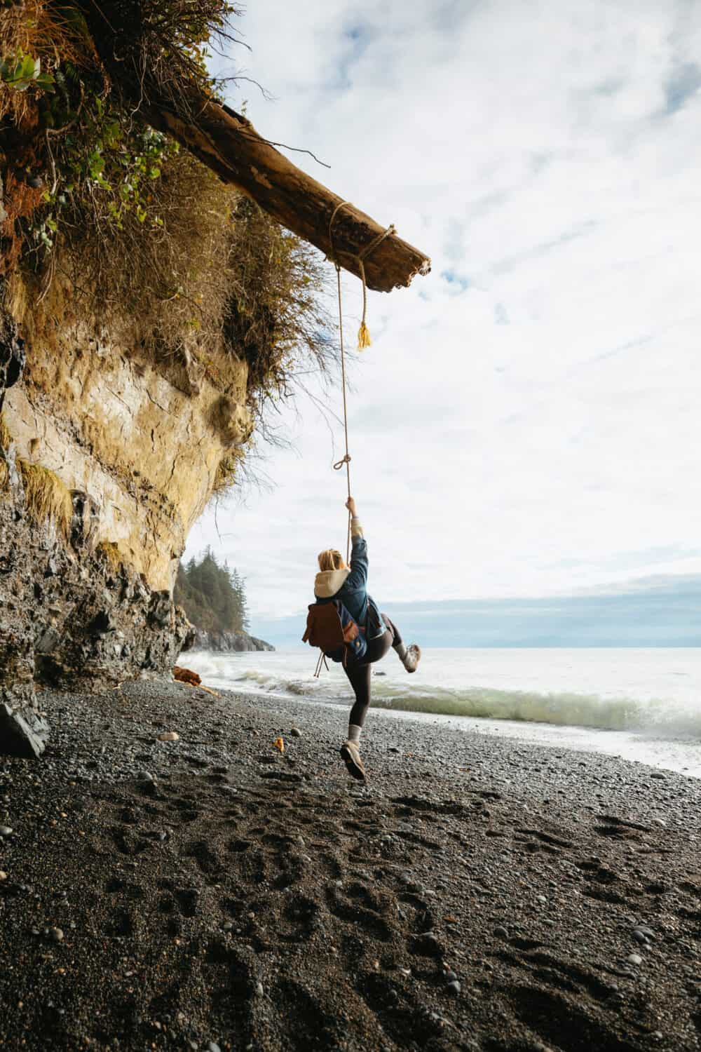 Emily Mandagie on rope swing at Mystic Beach, Vancouver Island - TheMandagies.com