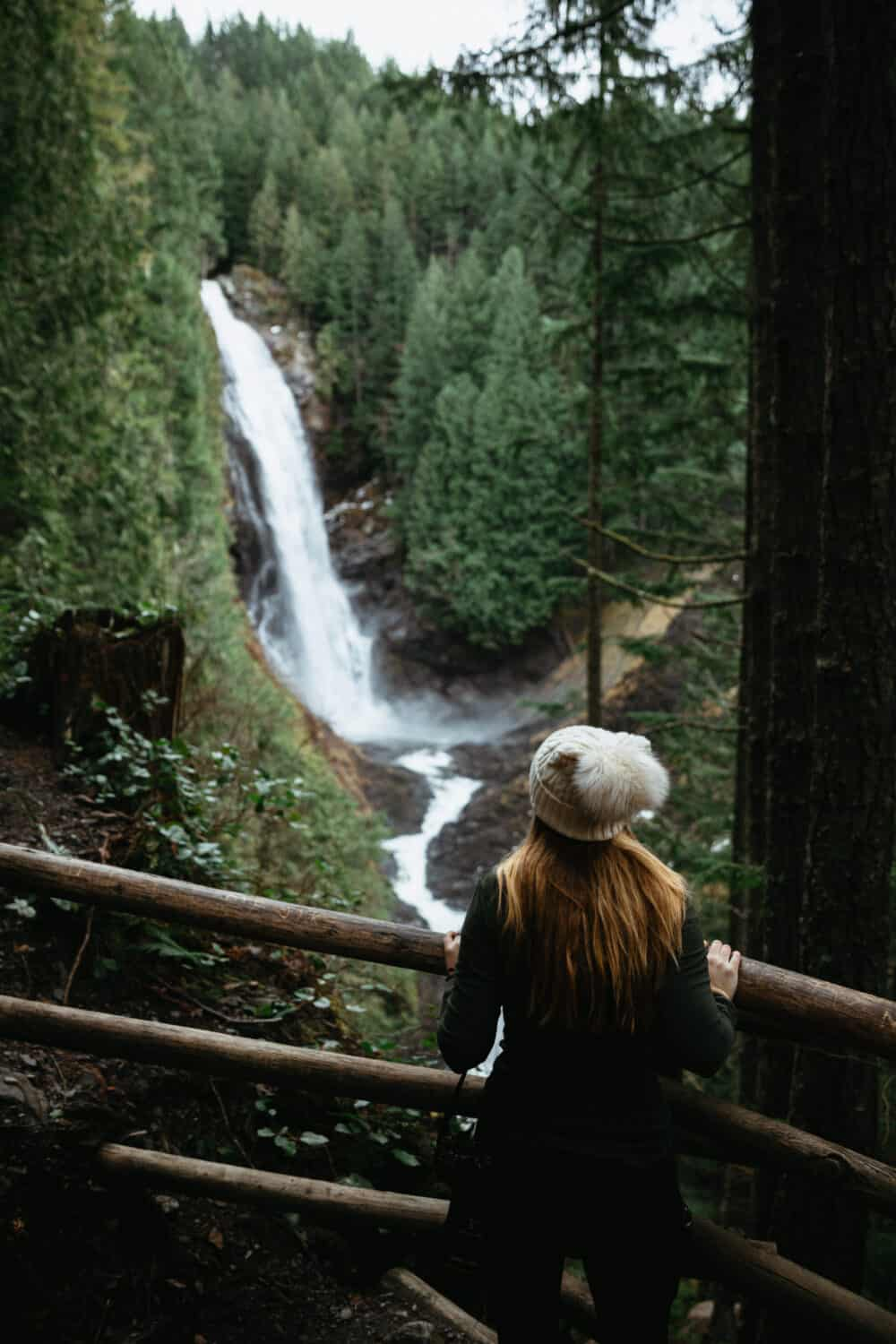 Emily Mandagie standing at Lower Viewpoint, Wallace Falls State Park - Washington - TheMandagies.com