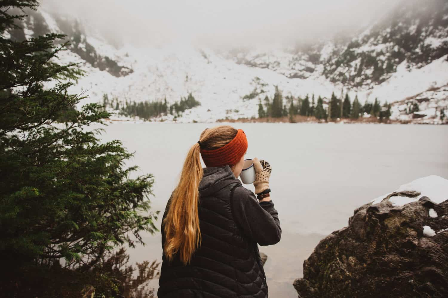 Emily Mandagie sipping coffee at Heather Lake - Mountain Loop Highway - Hiking Trails Near Seattle, Washington - Themandagies.com