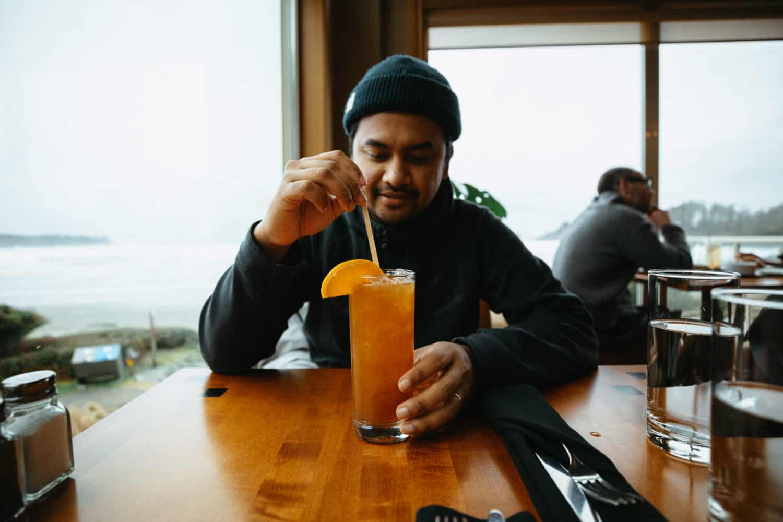 Berty Mandagie having drinks at Long Beach Lodge dining room