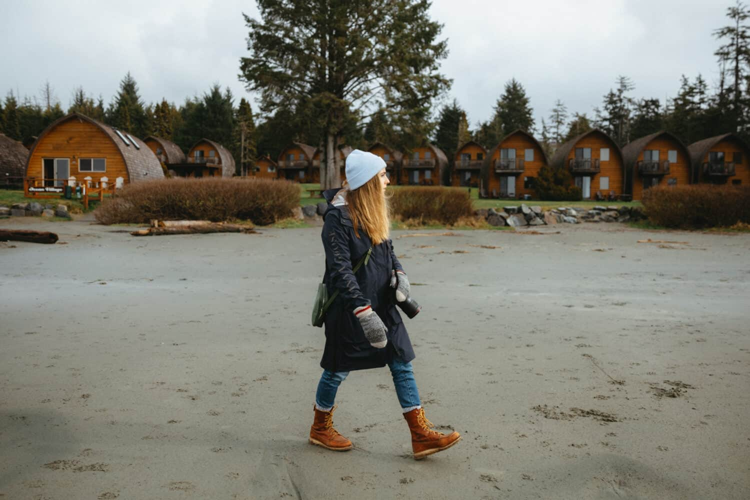 Emily Mandagie walking on beaches in Tofino, BC
