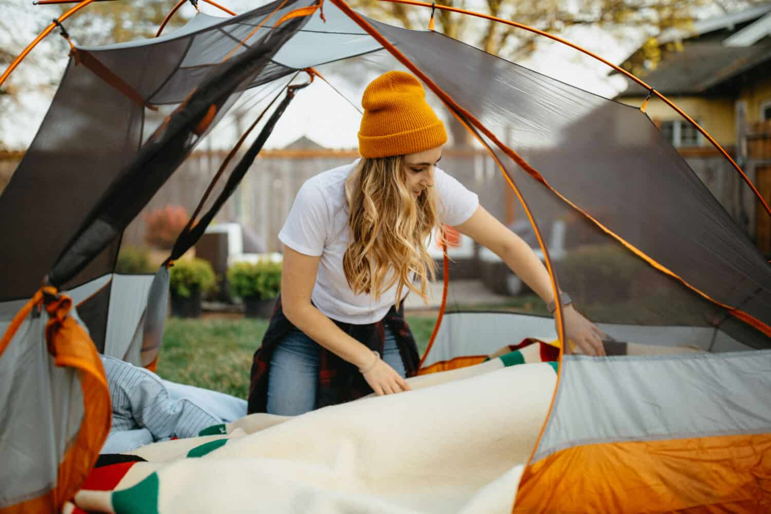 Emily Mandagie setting up backyard camping area