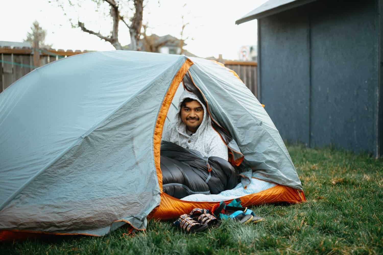 Berty Mandagie inside a sleeping bag