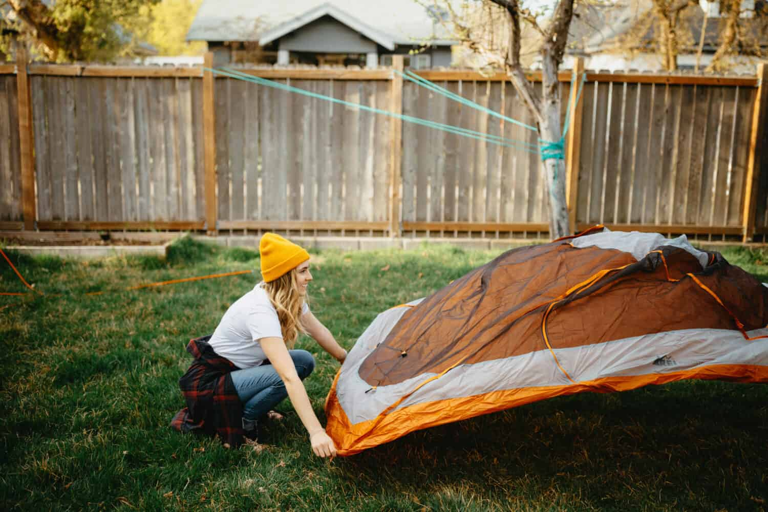 Emily Mandagie setting up backyard tent