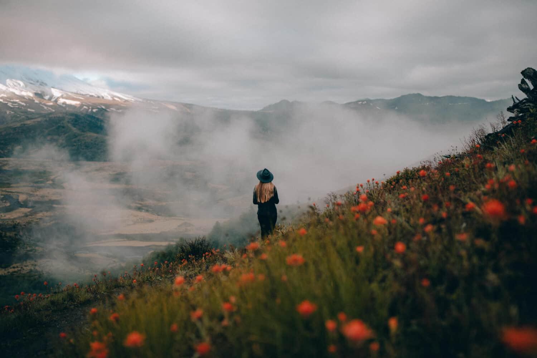 Emily Mandagie standing on trail near Mt St Helens, Washington - TheMandagies.com