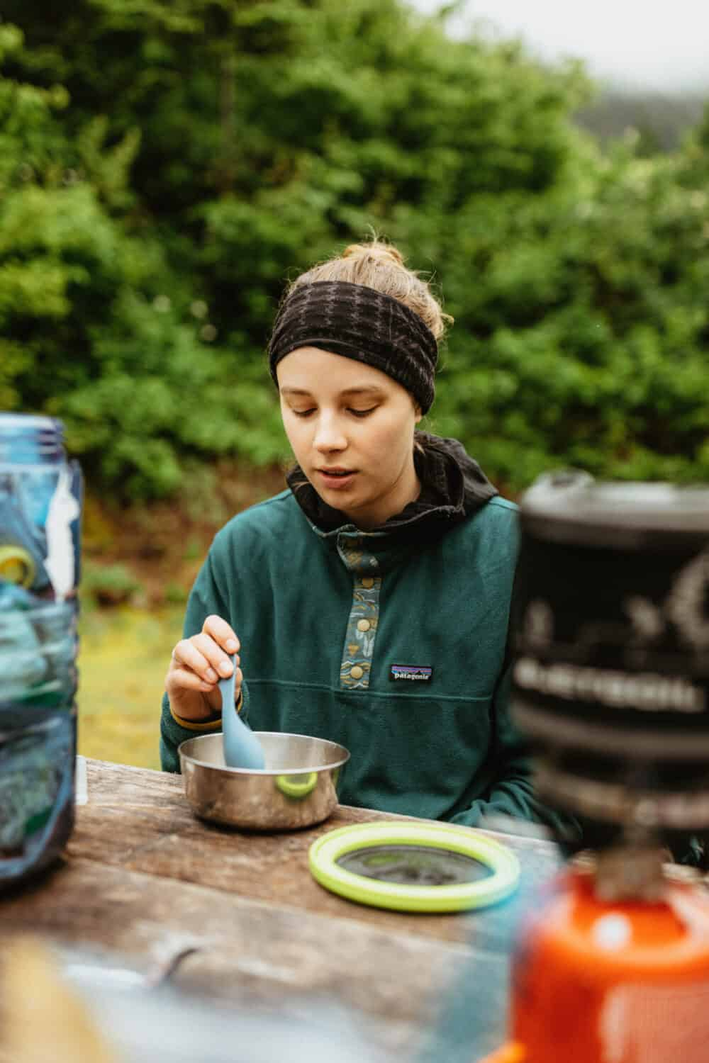 Katie eating camping meals while backpacking