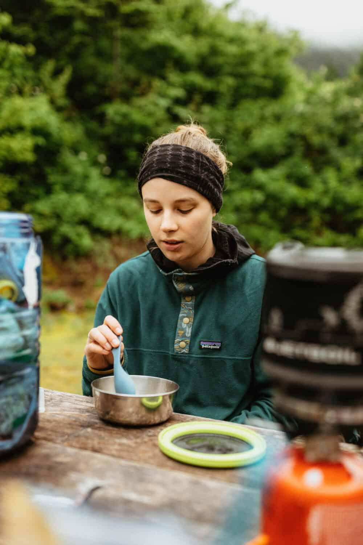 Katie Wyatt eating a backpacking meal