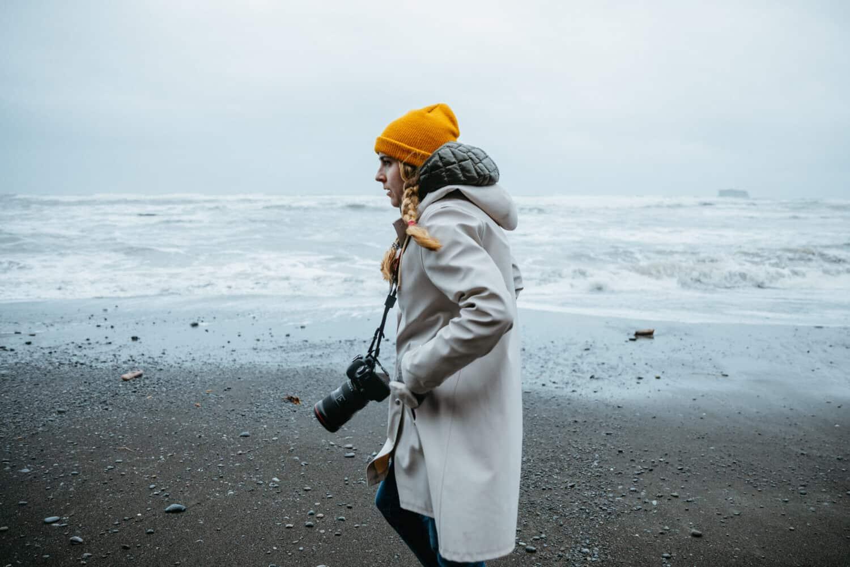 Emily Mandagie wearing raincoat on Washington Coast - TheMandagies.com