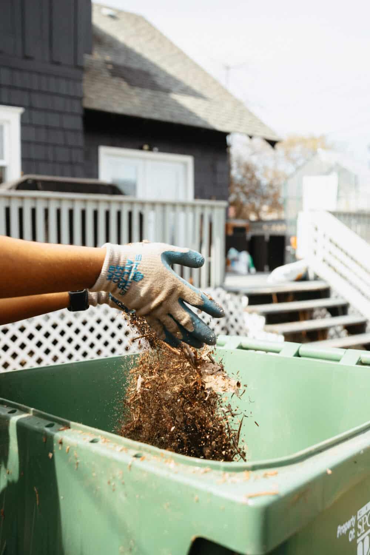 Close up hands dropping leaf debris - TheMandagies.com