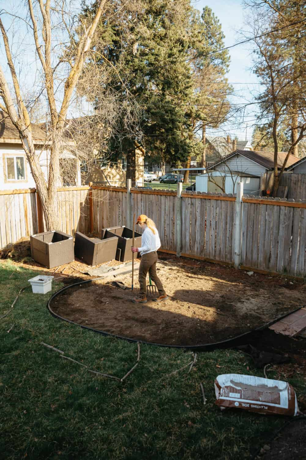 Emily Mandagie leveling for simple fire pit set up - TheMandagies.com