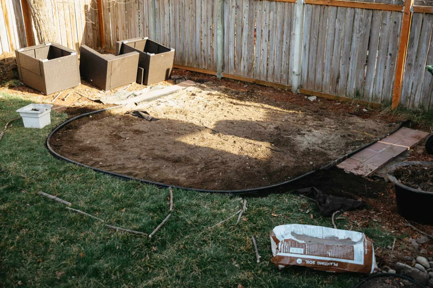 Landscape Border Install for how to build a fire pit - TheMandagies.com