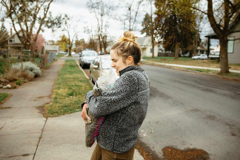 Emily Mandagie carrying pea gravel