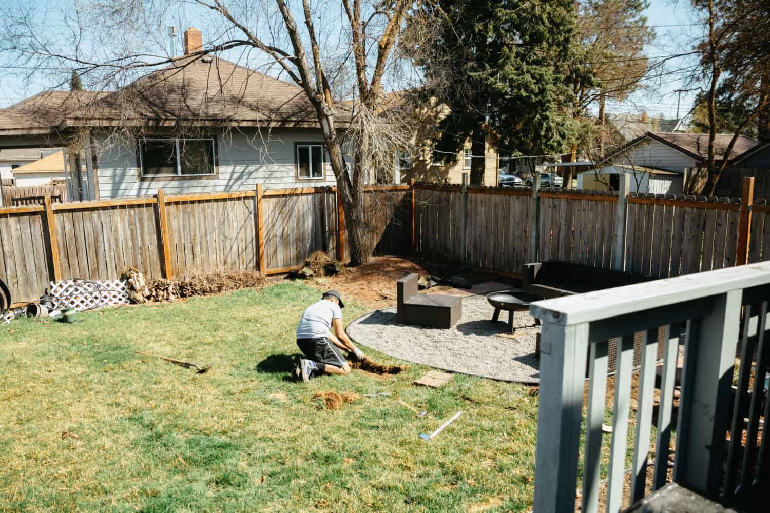 Berty Mandagie removing sod from the backyard fire pit area - TheMandagies.com