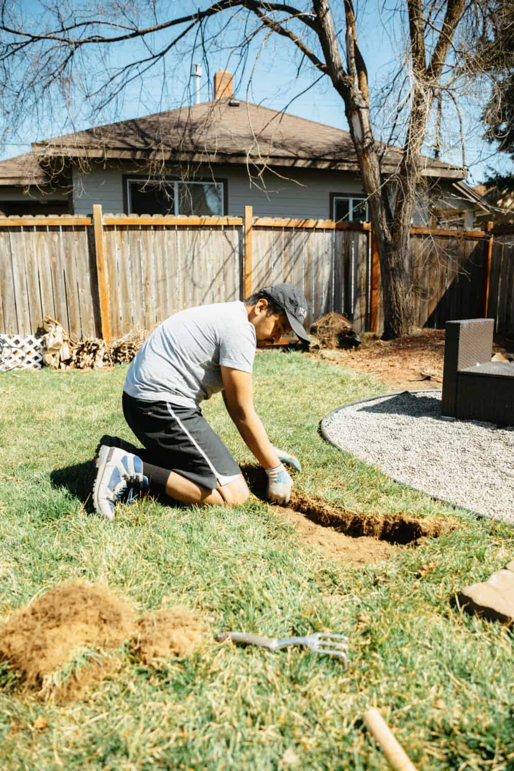 Berty Mandagie removing sod for flower beds - TheMandagies.com