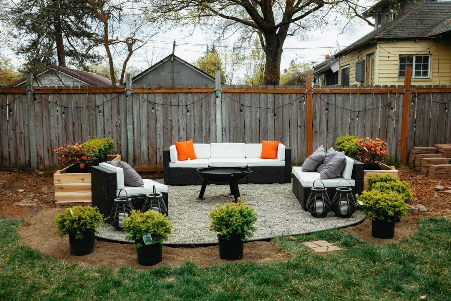 Filling homemade fire pit with plants and flowers - TheMandagies.com