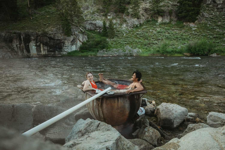 Berty and Emily Mandagie sharing small Idaho hot springs
