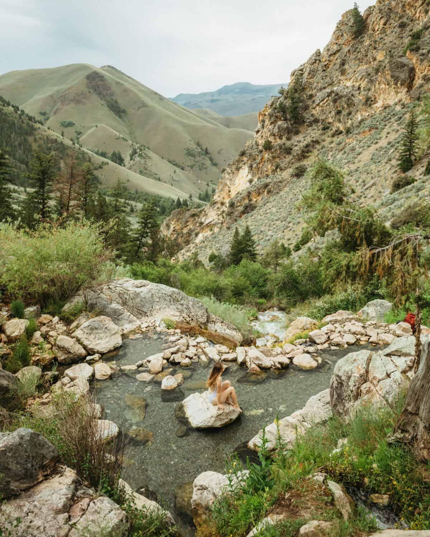 Emily Mandagie sitting at Goldbug Hot Springs