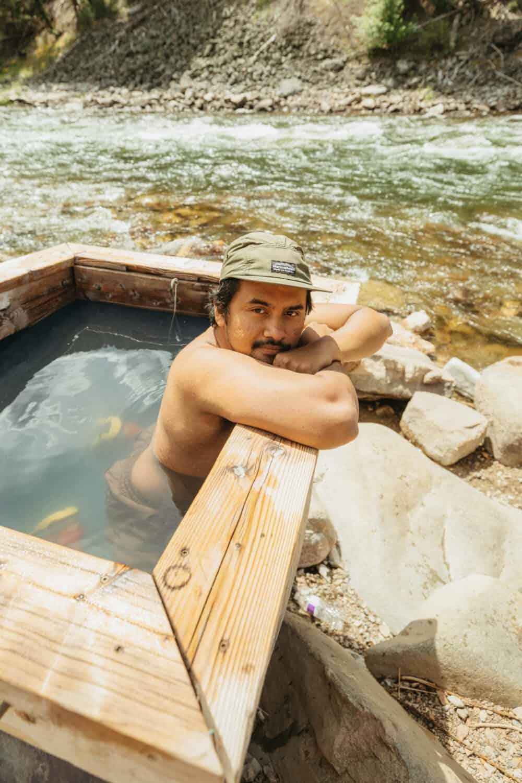 Berty Mandagie soaking in hot springs