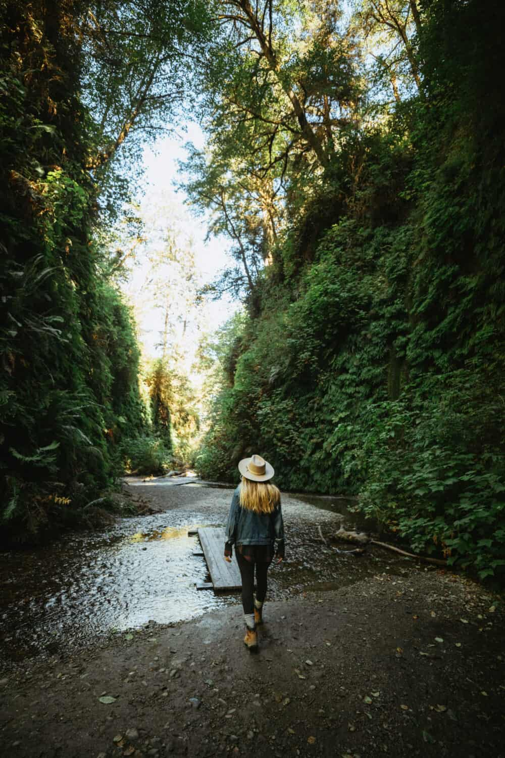 Emily Mandagie walking in Fern Canyon - Places in Northern California