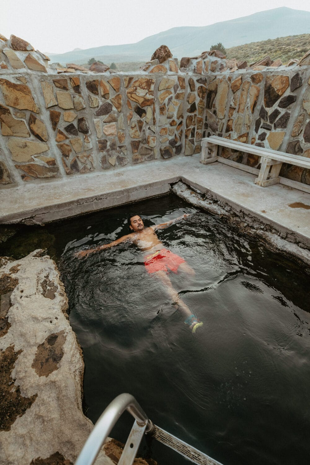 Berty Mandagie floating in Hart Mountain Hot Springs