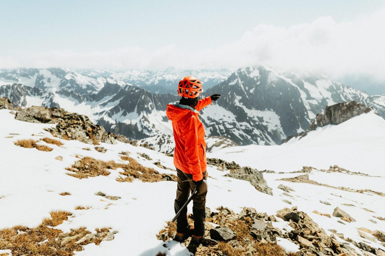 Emily Mandagie pointing at the North Cascades mountain range in Washington