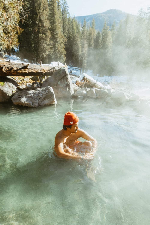 Berty Mandagie sitting in Jerry Johnson Hot Springs