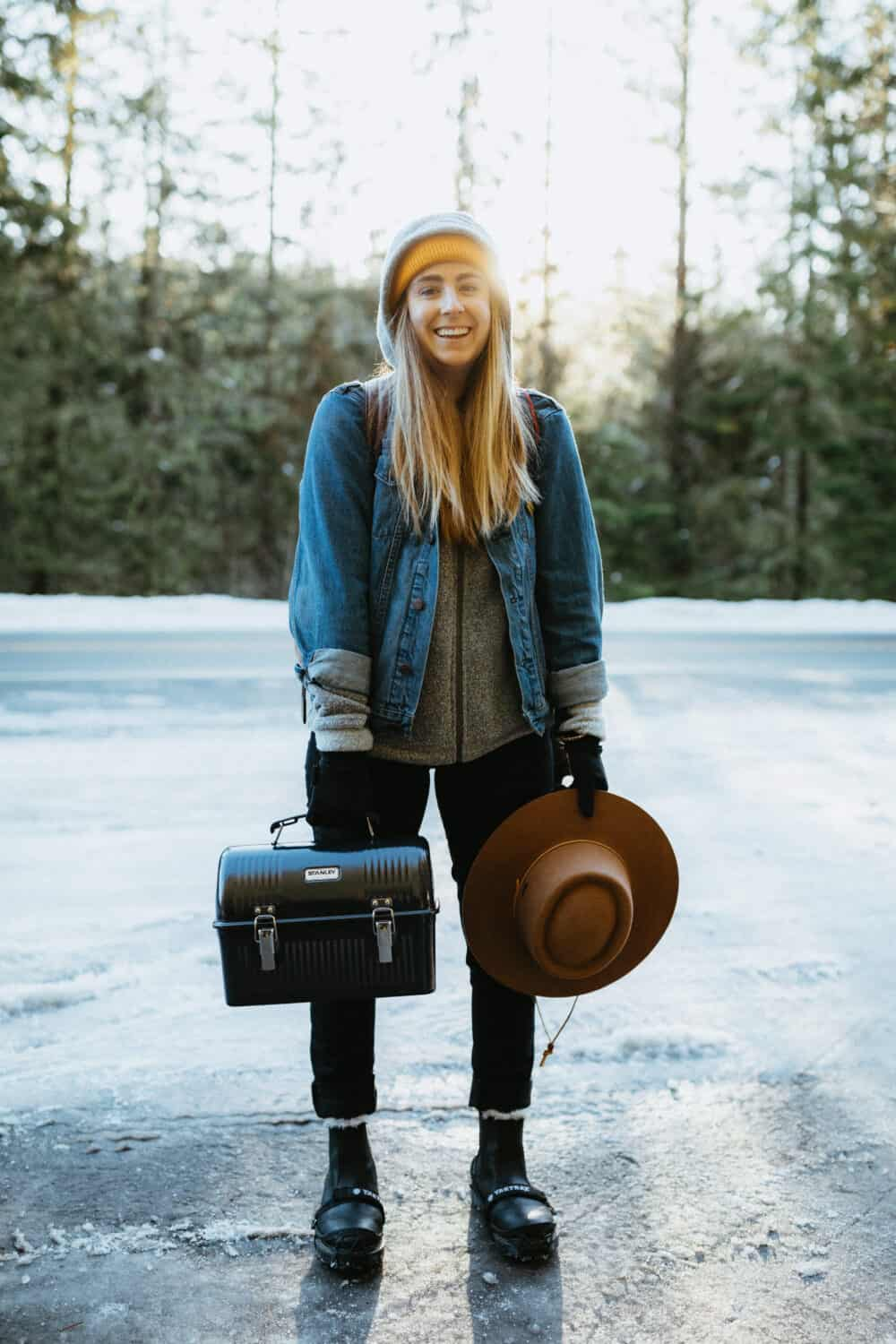 Emily Mandagie packing for a hot springs trip. Lunch box and hat