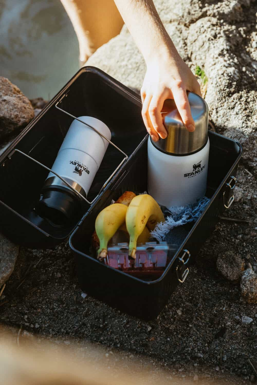 Stanley Classic Metal Lunchbox with breakfast items (banana, oatmeal, napkin, berries)