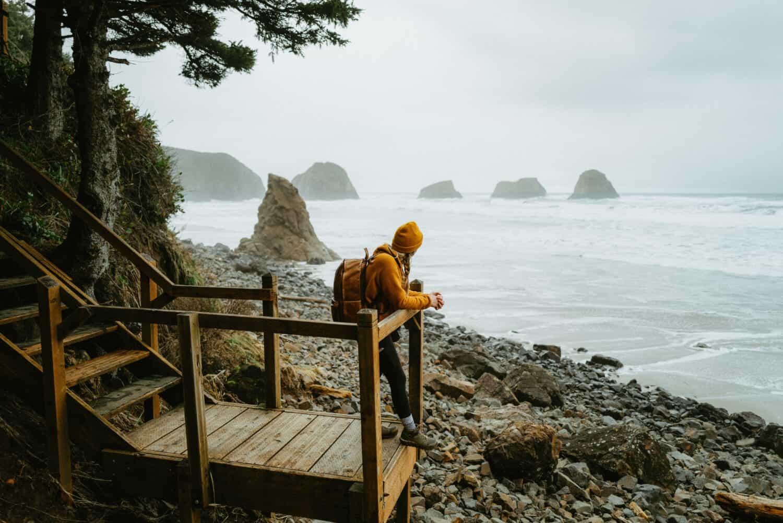 Emily Mandagie overlooking the Oregon Coast at Crescent Beach