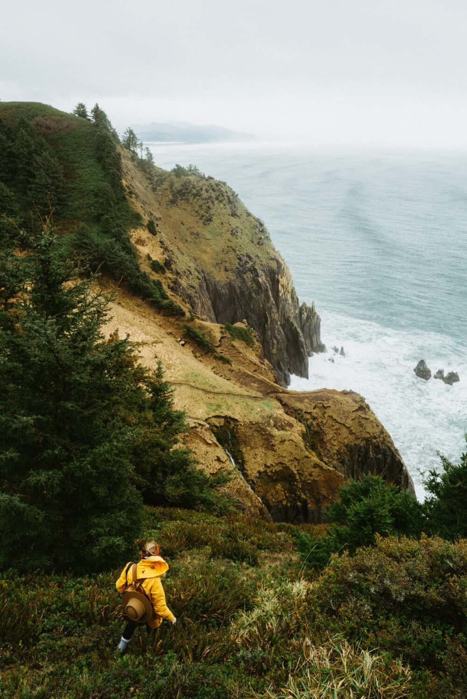 Emily Mandagie walking on trail near Neahkahie Cliffs