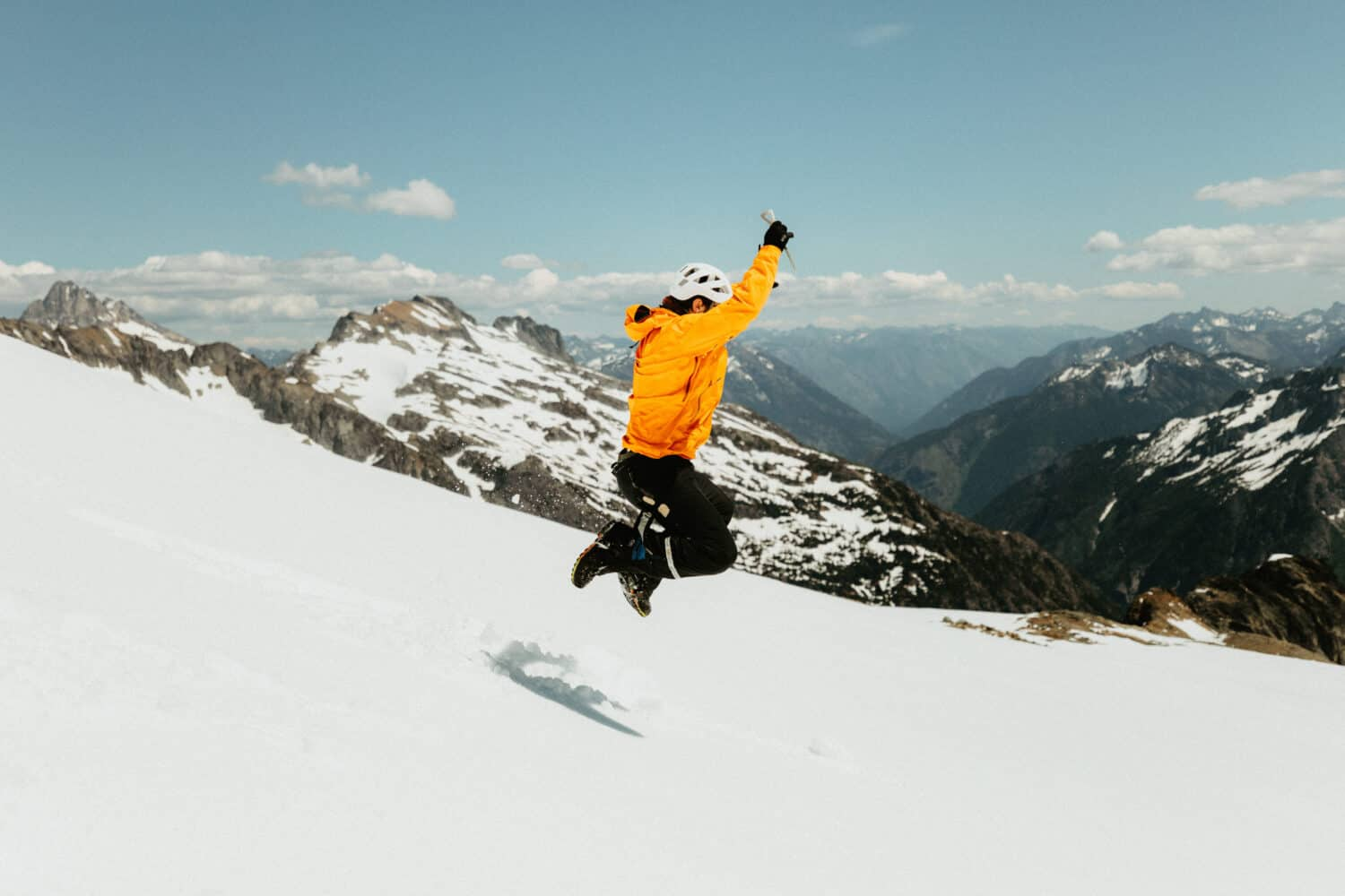 Joseph Roberts testing out an ice axe in North Cascades National Park