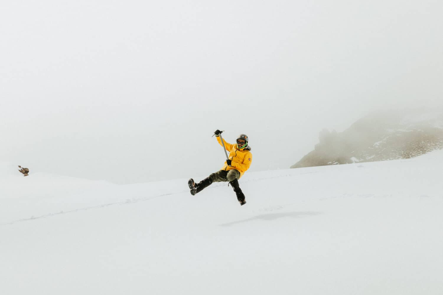 Berty Mandagie testing out an ice axe in the snow