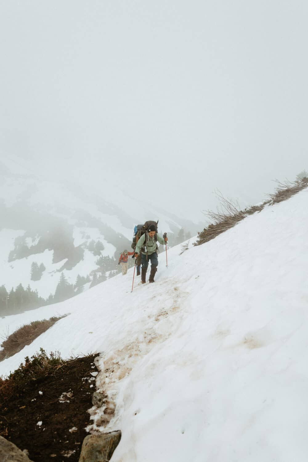 Berty Mandagie hiking in the snow in the North Cascades in July