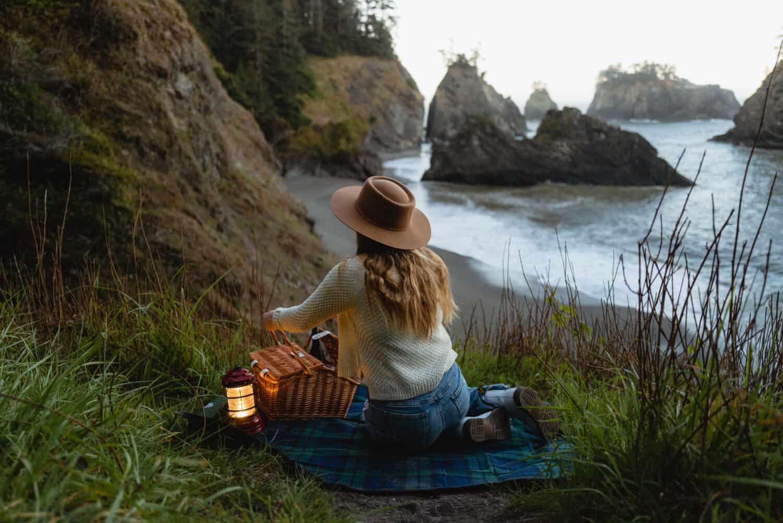 Emily Mandagie having a picnic at Secret Beach in Oregon