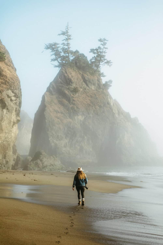 Emily Mandagie walking on the beach at Secret Beach on the Oregon Coast