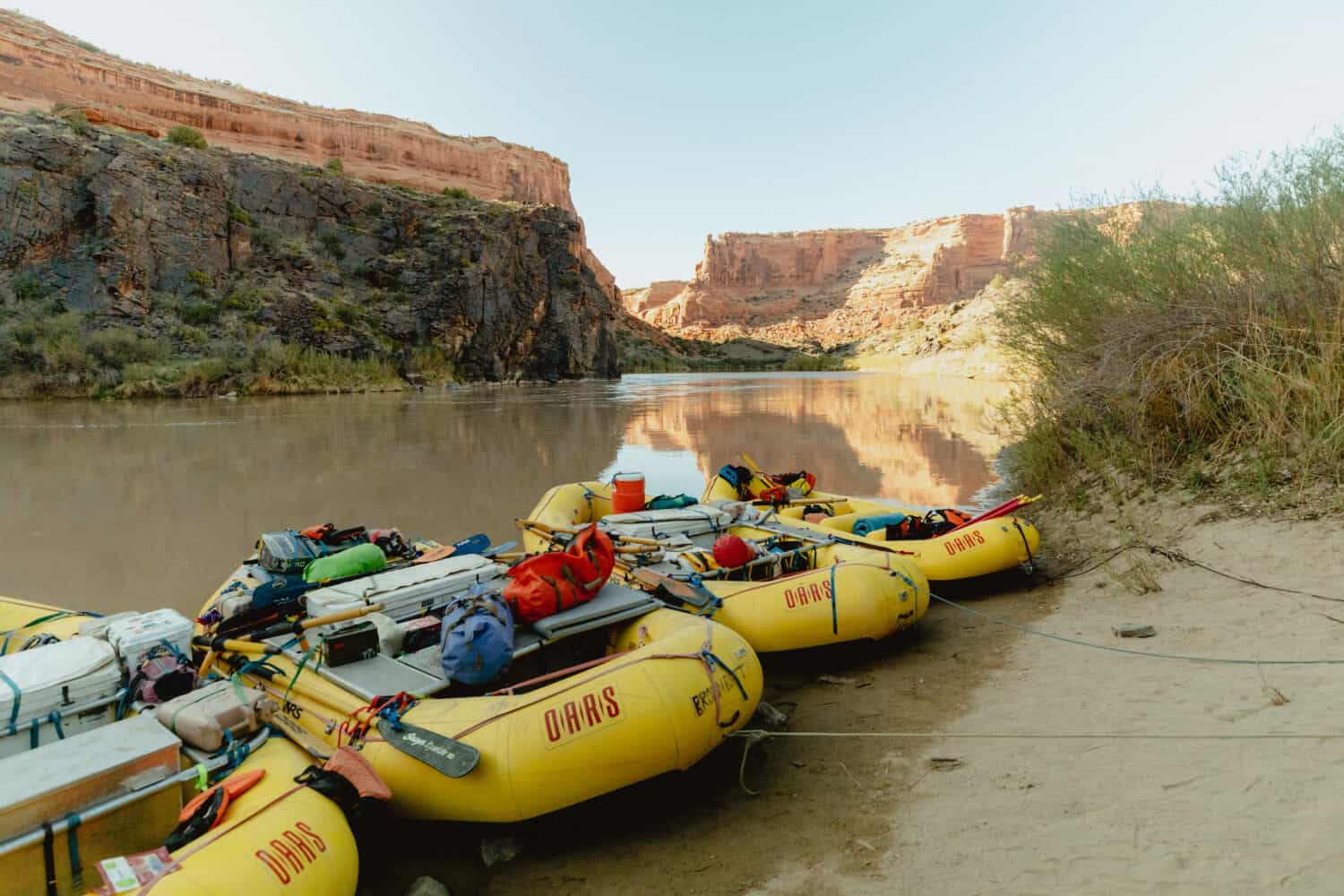 River rafting boats on Westwater Canyon during sunset